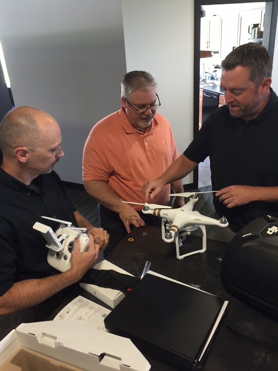 Brent, Phil and Scott check out the new AKC drone.